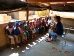 Rebecca sharing with a group of orphans about what it means to belong to the family of God