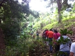 The medic team and AMOS staff hiking to make a site visit in Cumaica Norte