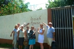 a team in front of the Isaiah House
